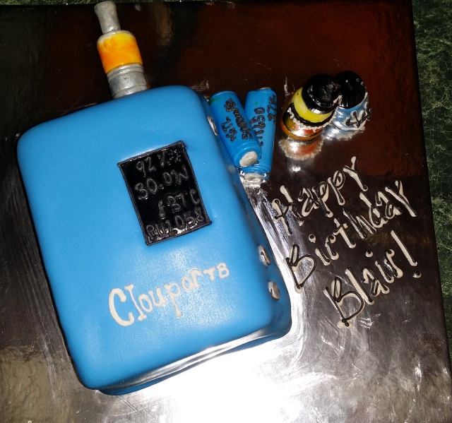 Awesome Vape Cake! ClouporT8, with Nautilus tank, two batteries, and a bottle of Mother's Milk and VG.