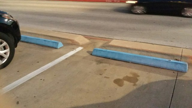 Who's the butthead who painted all the curb stops the same color as handicap parking?
